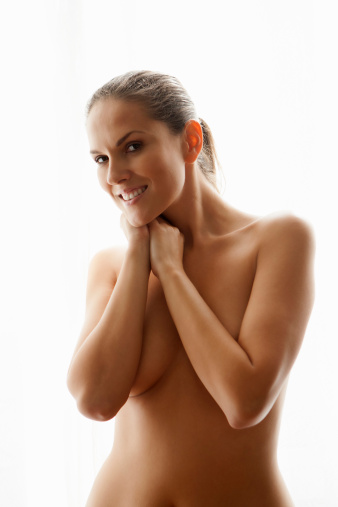 Benefits of Natural Breast Enlargement for Women Using Natural Products - Nude lady covering breasts
