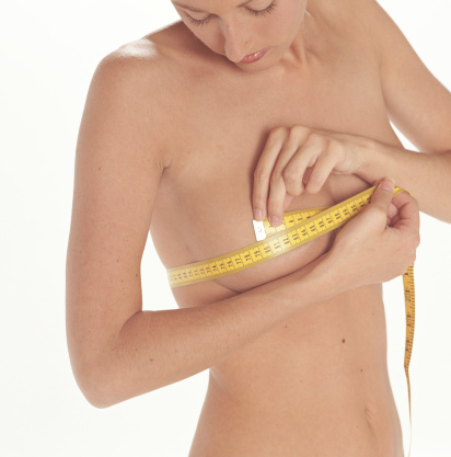 Natural Breast Enhancement Products - Woman measuring breasts