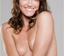 Smiling Woman Covering Breasts
