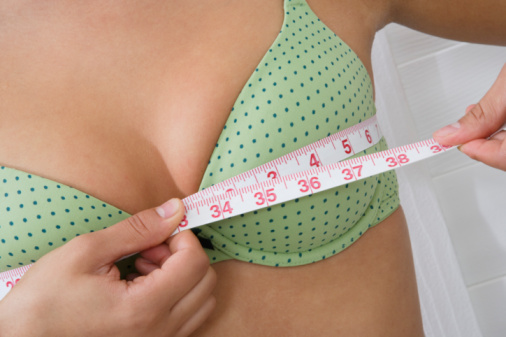 Are the Effects of Breast Creams Permanent - Woman measuring breasts