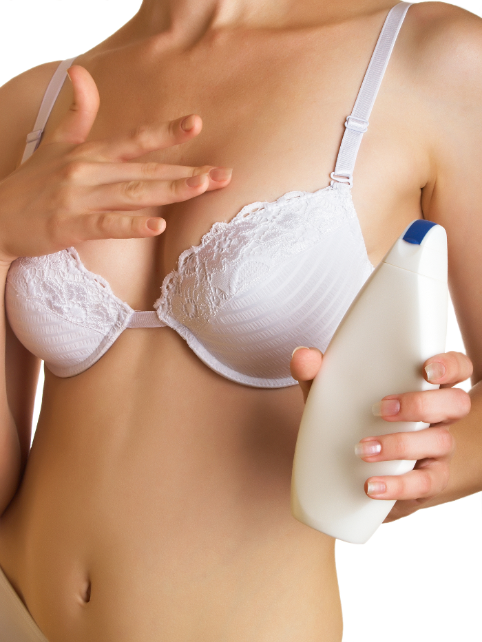 Woman applying breast cream